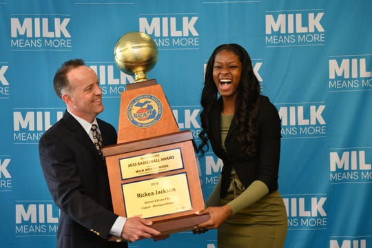 Rickea Jackson of Detroit Edison accepts the trophy as the winner of the 2019 Miss Basketball award for Michigan from BCAM executive director Dan Young during a ceremony Monday in downtown Detroit.