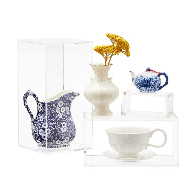 Displaying pieces at different levels adds interest while acrylic holders keep the look light.