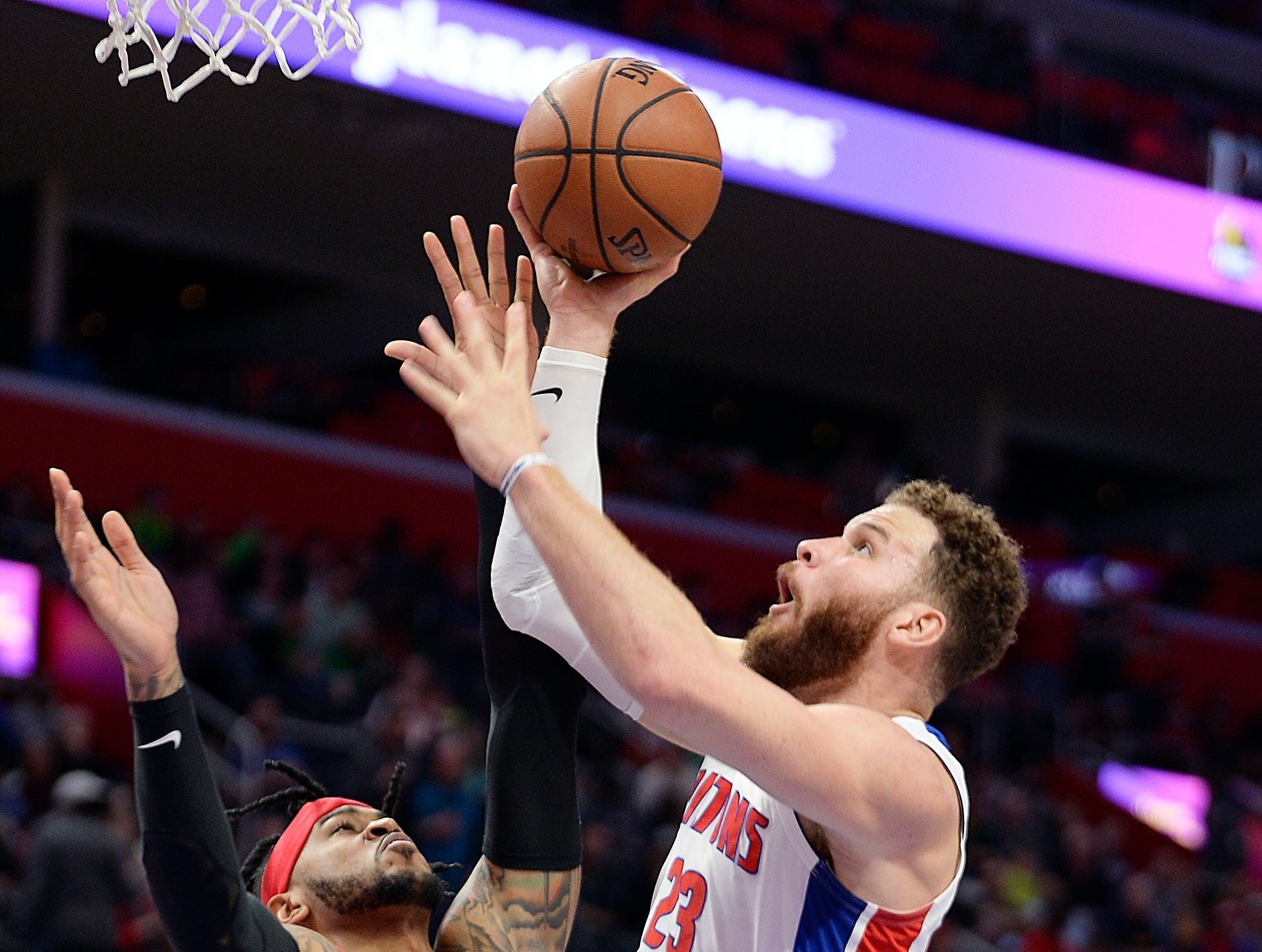 Pistons' Blake Griffin scores over Raptors' Eric Moreland in the fourth quarter.