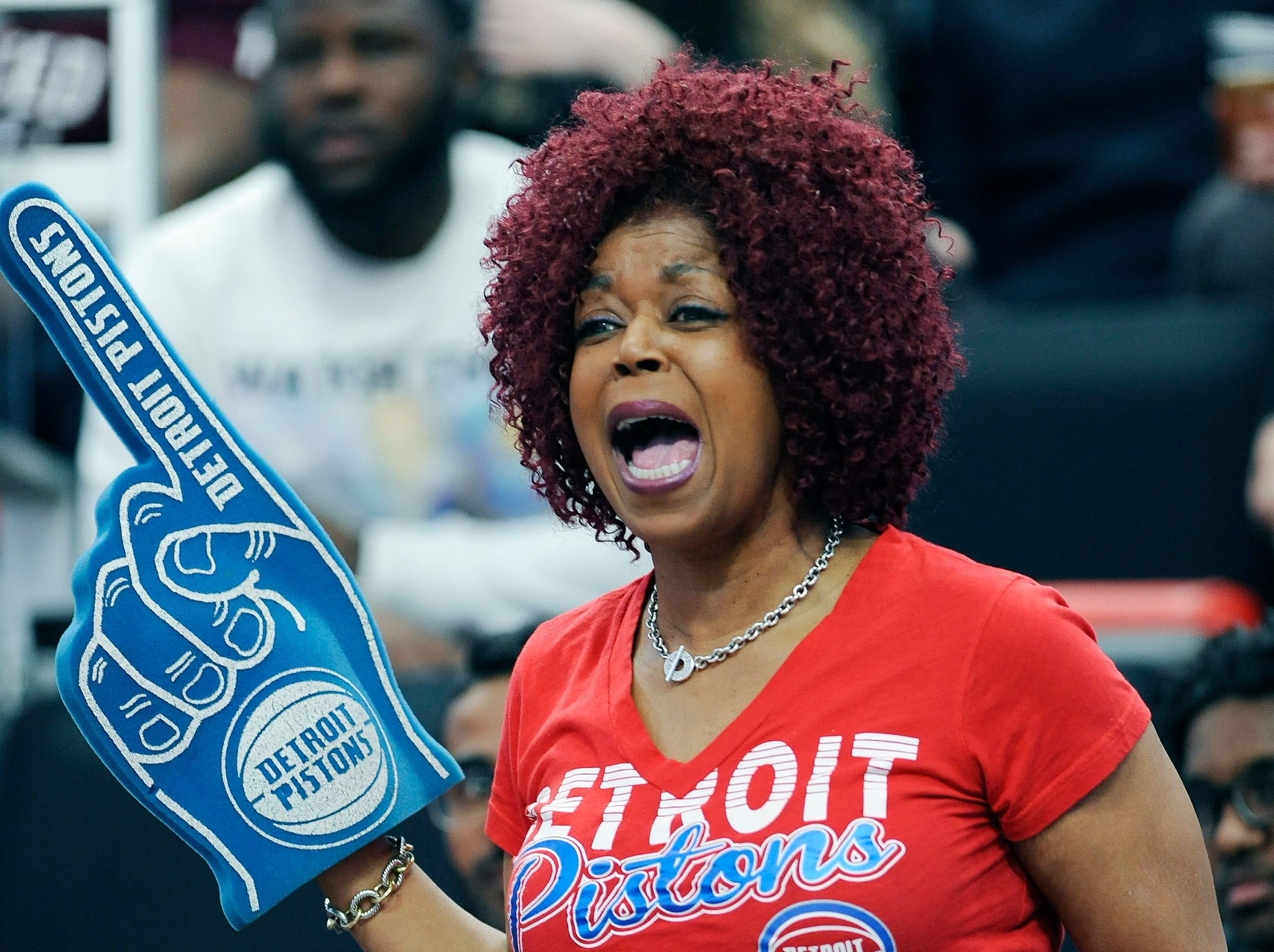 Kathy Morrow, 58, of Southfield cheers for the Pistons in the first quarter.