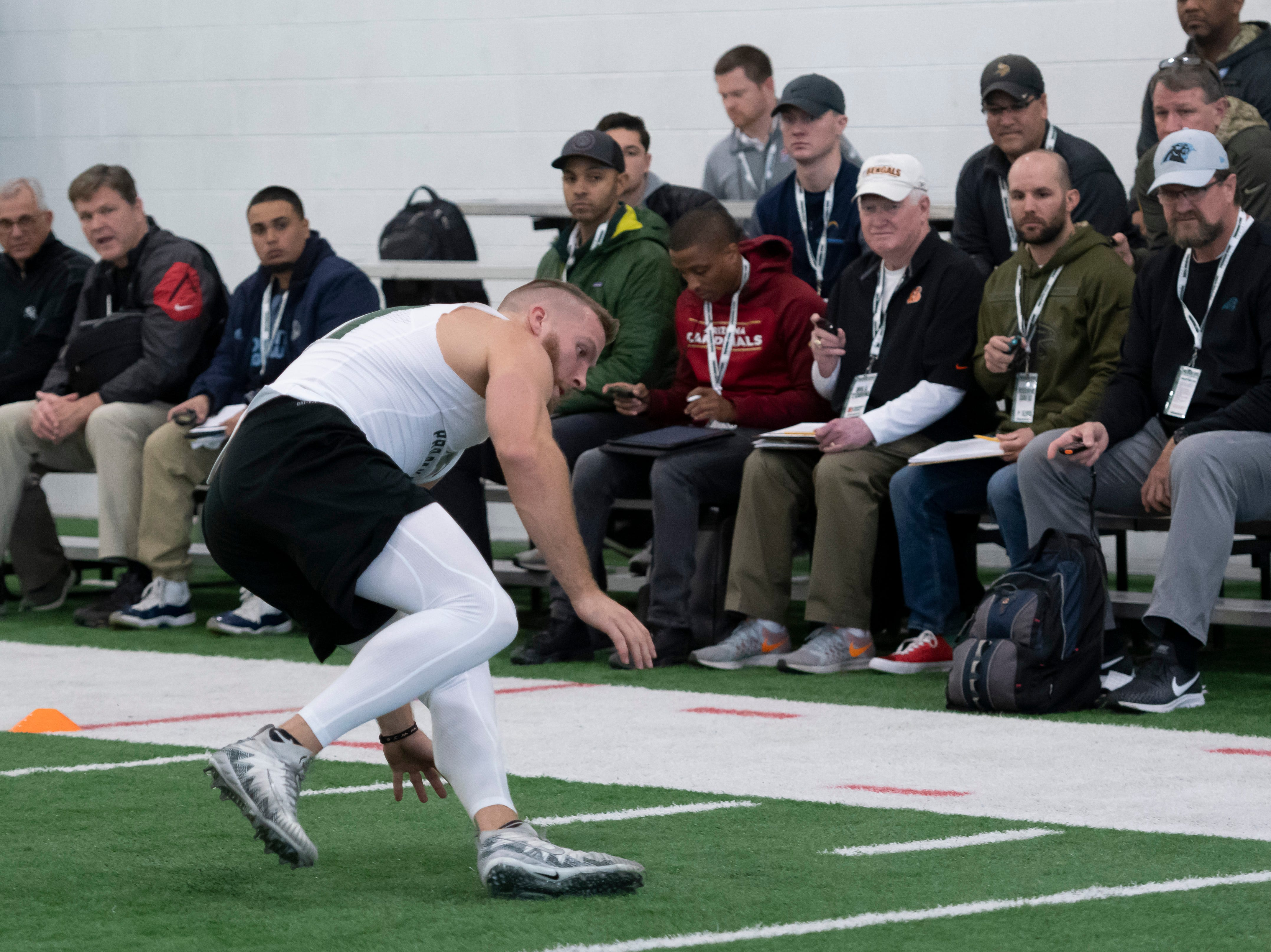Michigan State tight end Matt Sokol runs through shuttle drills under the watchful eyes of scouts and recruiters during an NFL pro day at the Duffy Daugherty Football facility, in East Lansing.