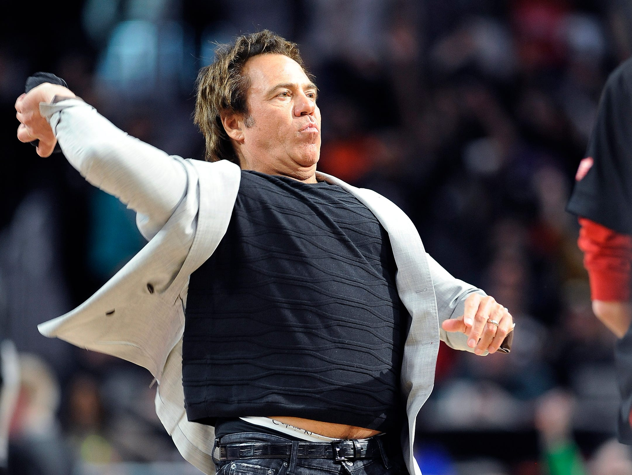 Pistons owner Tom Gores throws t-shirts to the fans in the fourth quarter.