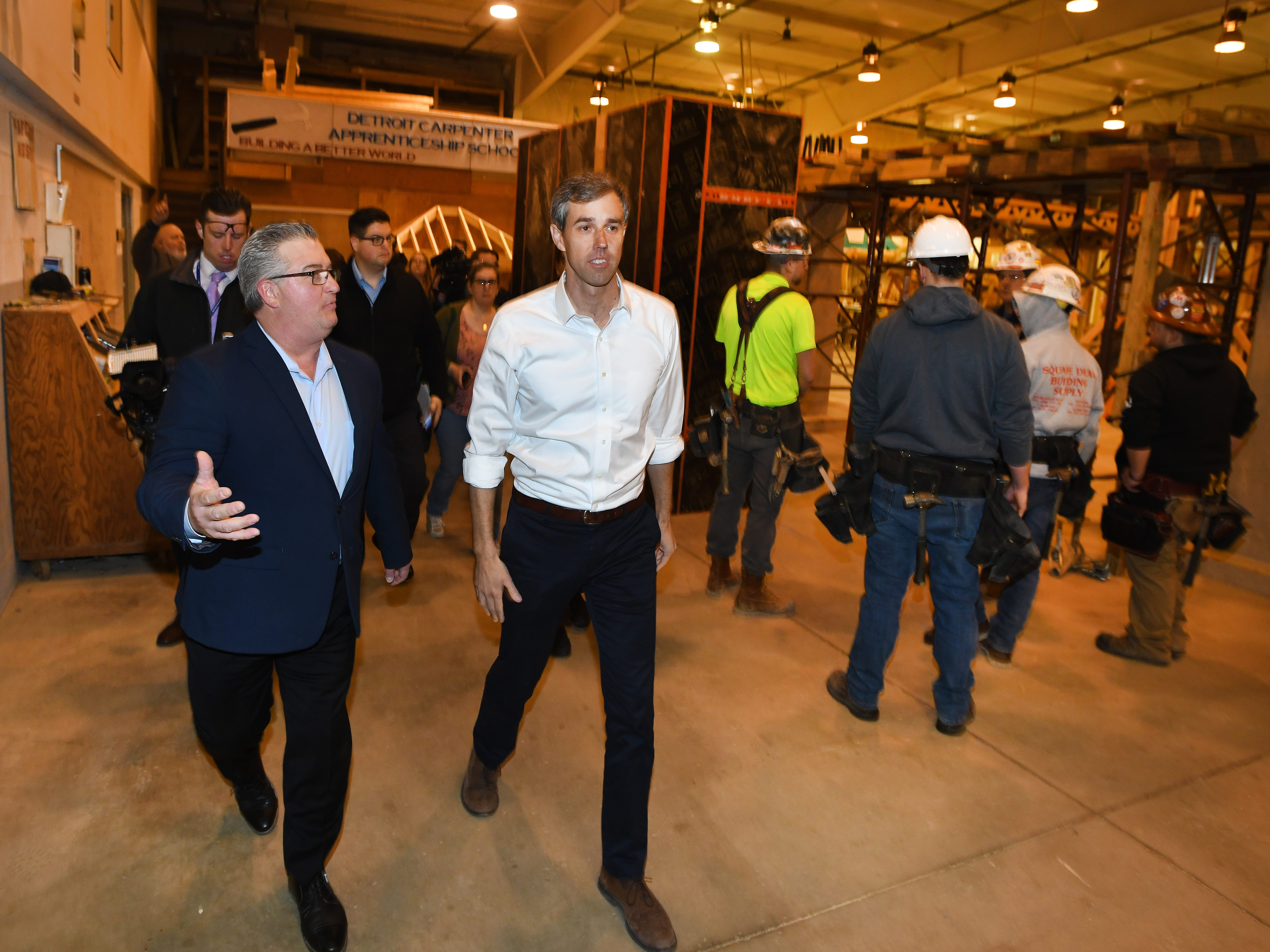 Michigan Regional Council of Carpenters President Tom Lutz shows Democratic U.S. presidential candidate Beto O'Rourke around the Detroit Carpenters Training Center during a tour in Ferndale, Michigan on March 18, 2019.