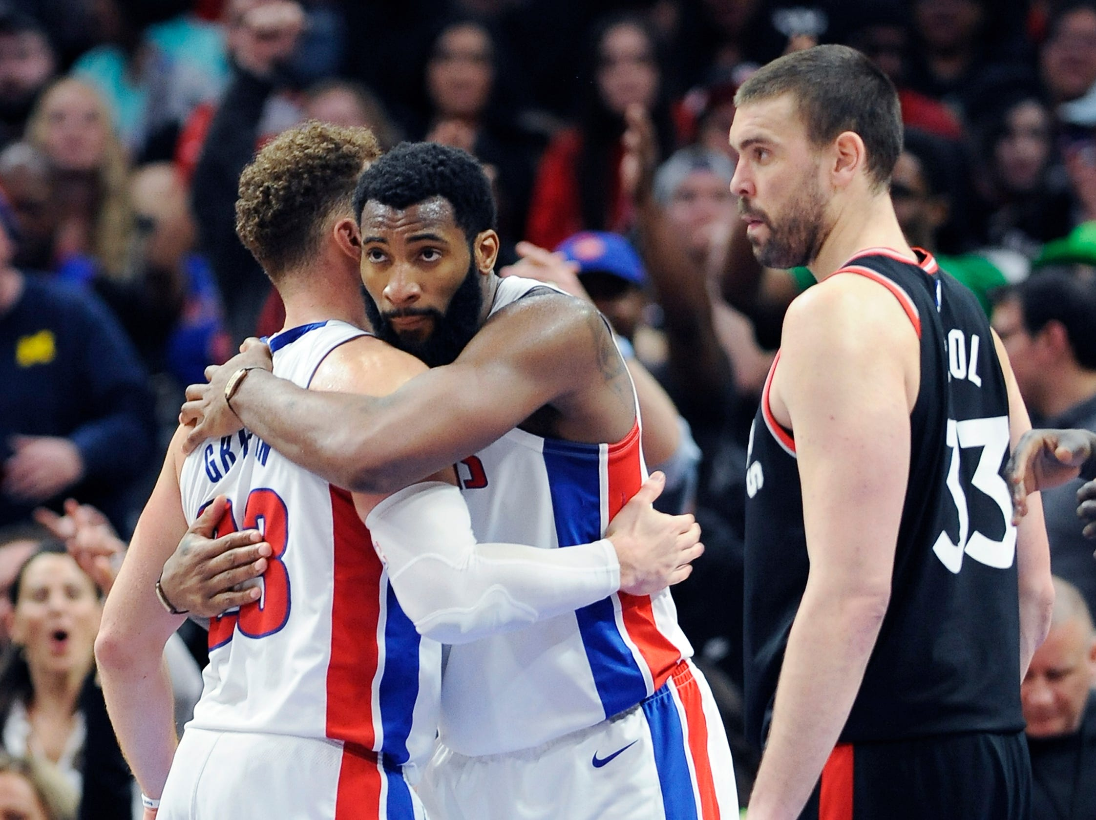 Pistons' Andre Drummond, (l), and Blake Griffin embrace at the end of the game.