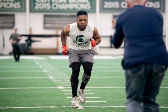 Michigan State safety Khari Willis runs through drills during an NFL pro day.