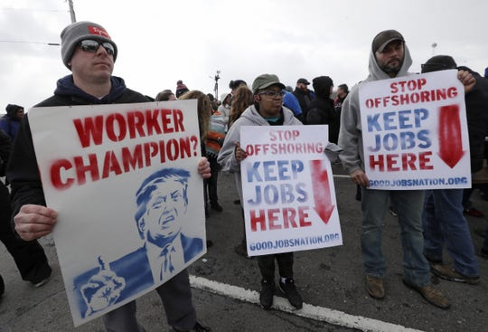 Workers protest March 6  outside GM's Lordstown, Ohio, plant, the last day of production at the factory. President Trump unleashed a Twitter storm about the plant before a Wednesday rally in Ohio.
