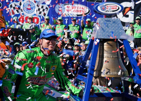 Kyle Busch celebrates after winning a NASCAR Cup Series auto race Sunday at Auto Club Speedway in Fontana, Calif.
