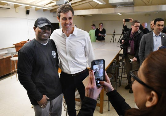 Commercial carpentry student Malcolm Kennedy gets a picture with Democratic U.S. presidential candidate Beto O'Rourke during a visit to the Detroit Carpenters Training Center in Ferndale, Monday.
