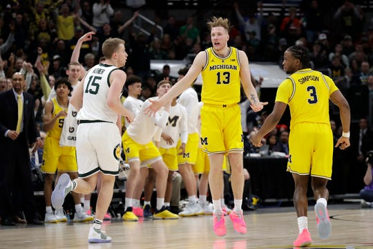 Michigan's Ignas Brazdeikis (13) had a team-high 19 points Sunday against Michigan State, but he was 2-of-8 shooting in the second half.