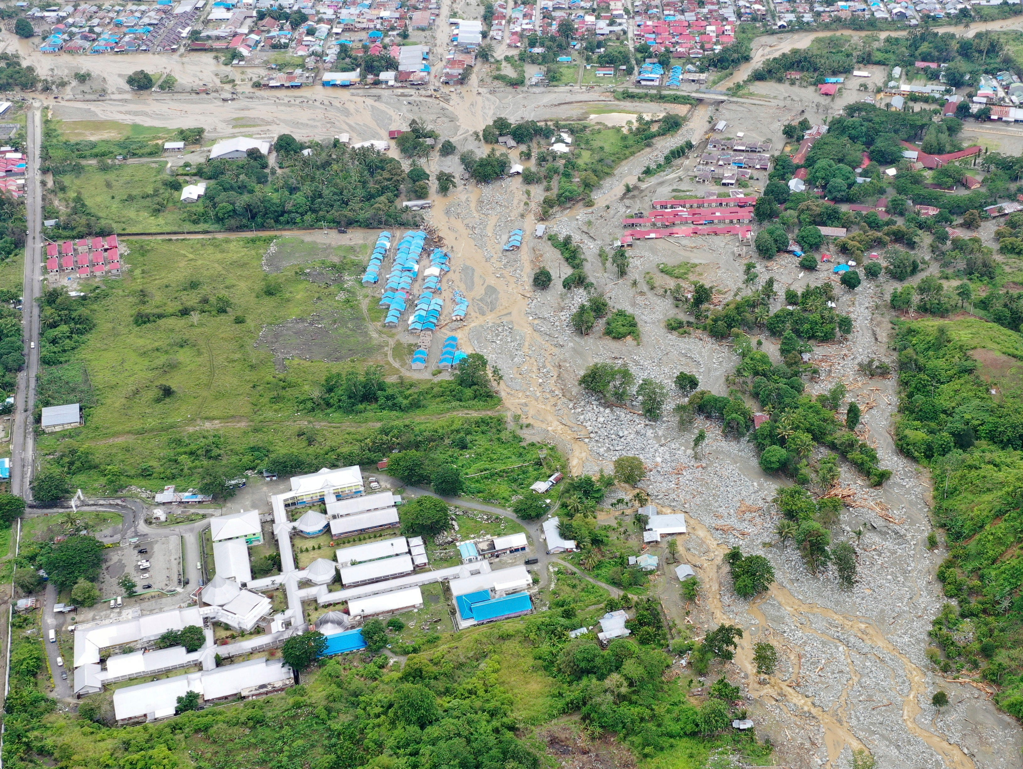 This aerial photo shows the area affected by flash floods in Sentani, Papua province, Indonesia, Monday, March 18, 2019. Flash floods and mudslides triggered by downpours tore through mountainside villages in Indonesia's easternmost province, killing dozens of people, disaster officials said.