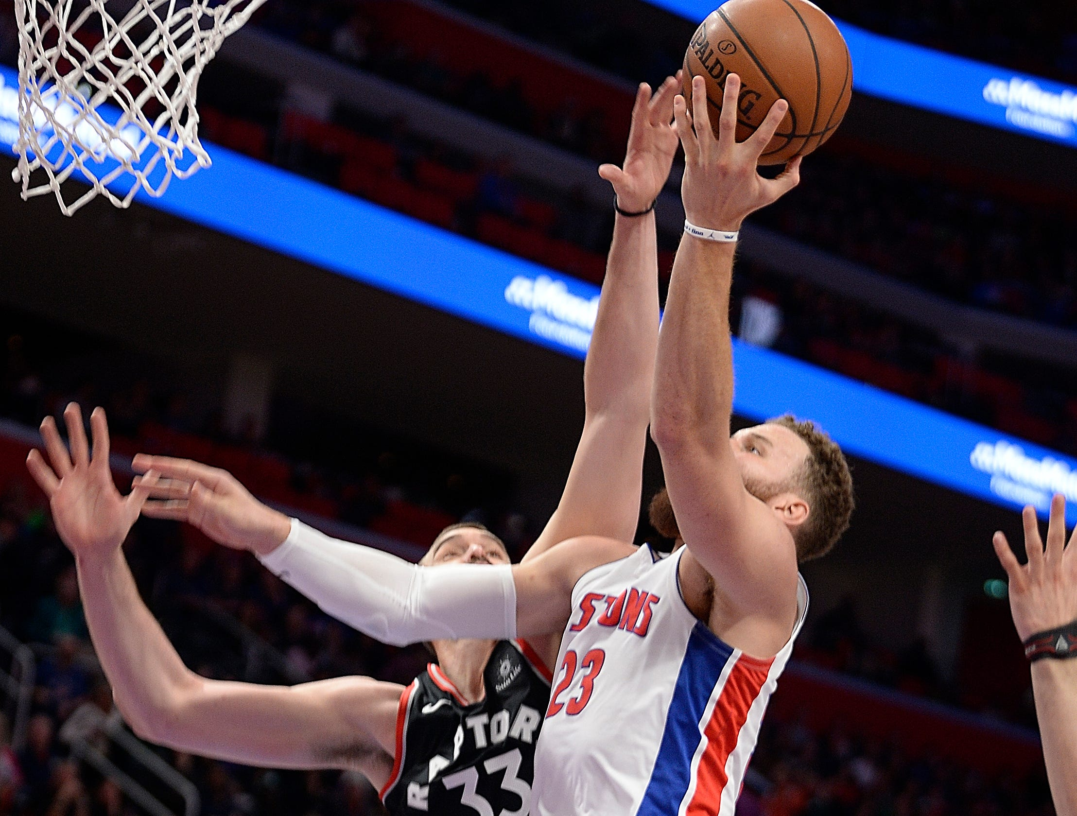 Pistons' Blake Griffin scores over Raptors' Marc Gasol in the fourth quarter. Griffin had 25 points and 8 rebounds.