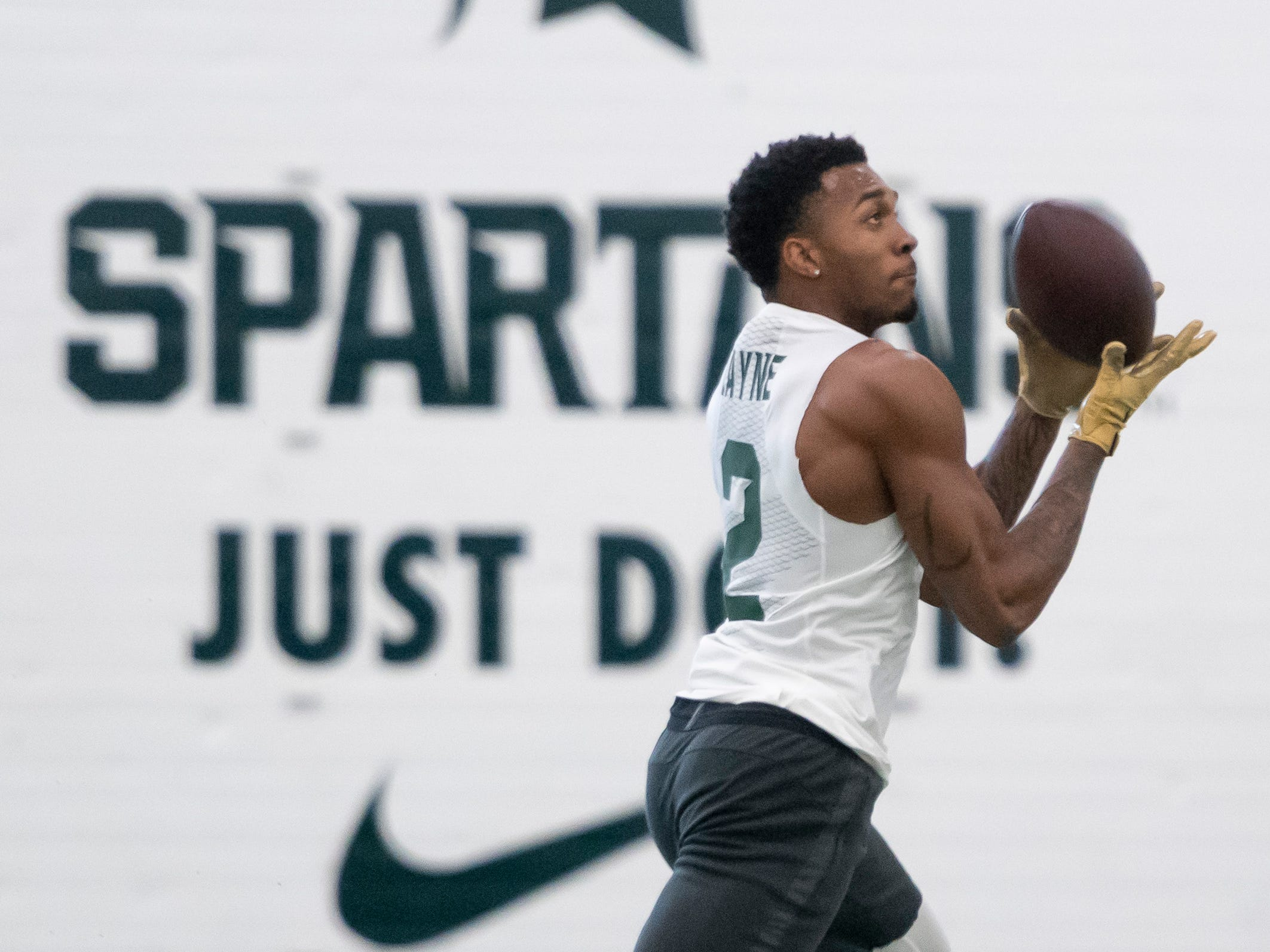Michigan State cornerback Justin Layne catches a pass during an NFL pro day at the Duffy Daugherty Football facility.