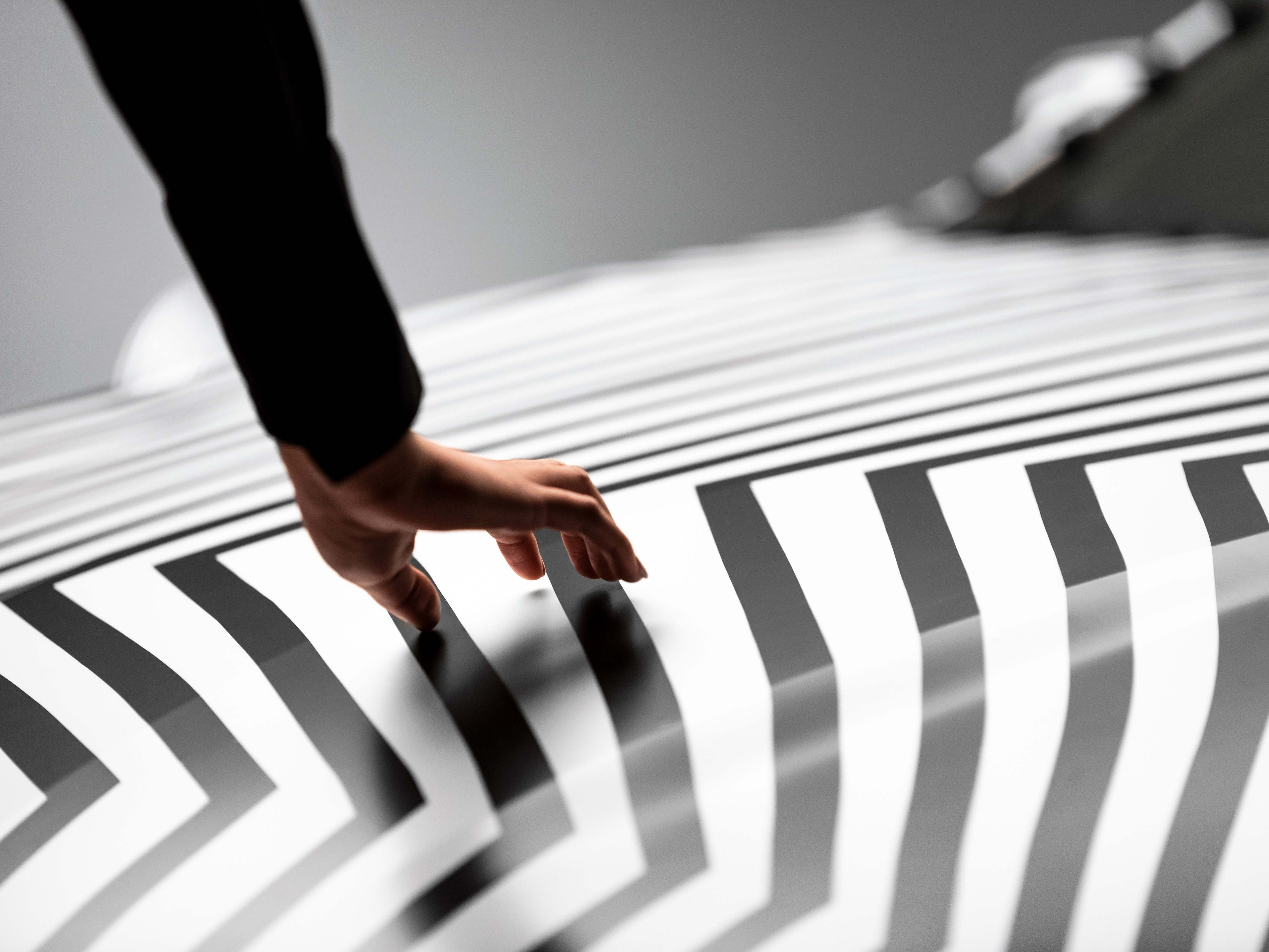 The Cadillac CT5 is being introduced through a series of YouTube videos leading up to its introduction at the NYC Auto Show April 17. Cadillac collaborated with artist Darel Carey to create a one-of-a-kind camouflage wrap for the Cadillac CT5. The black and white tape patterns reflect forms found in nature and distort the viewer's perception of space.