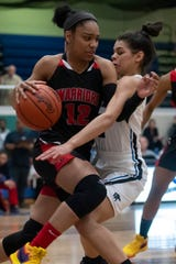 Guard Cheyenne McEvans (12) leads Southfield A&T into Tuesday's Division 1 state quarterfinals against St. Clair Shores Lakeview at West Bloomfield.