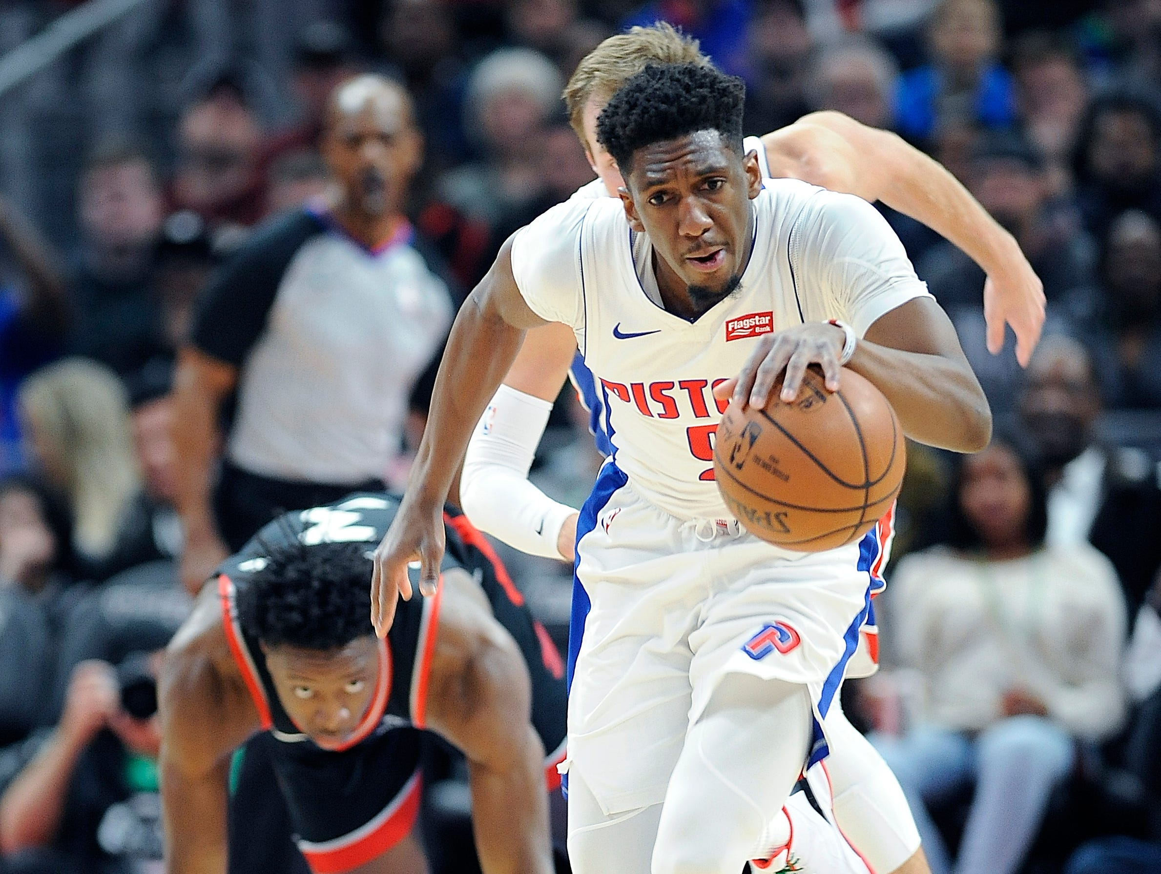 Pistons' Langston Galloway races up court after a steal by Luke Kennard in the fourth quarter.