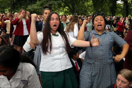 Students perform the Haka during a vigil to commemorate victims of Friday's shooting, outside the Al Noor mosque in Christchurch, New Zealand, Monday, March 18, 2019.