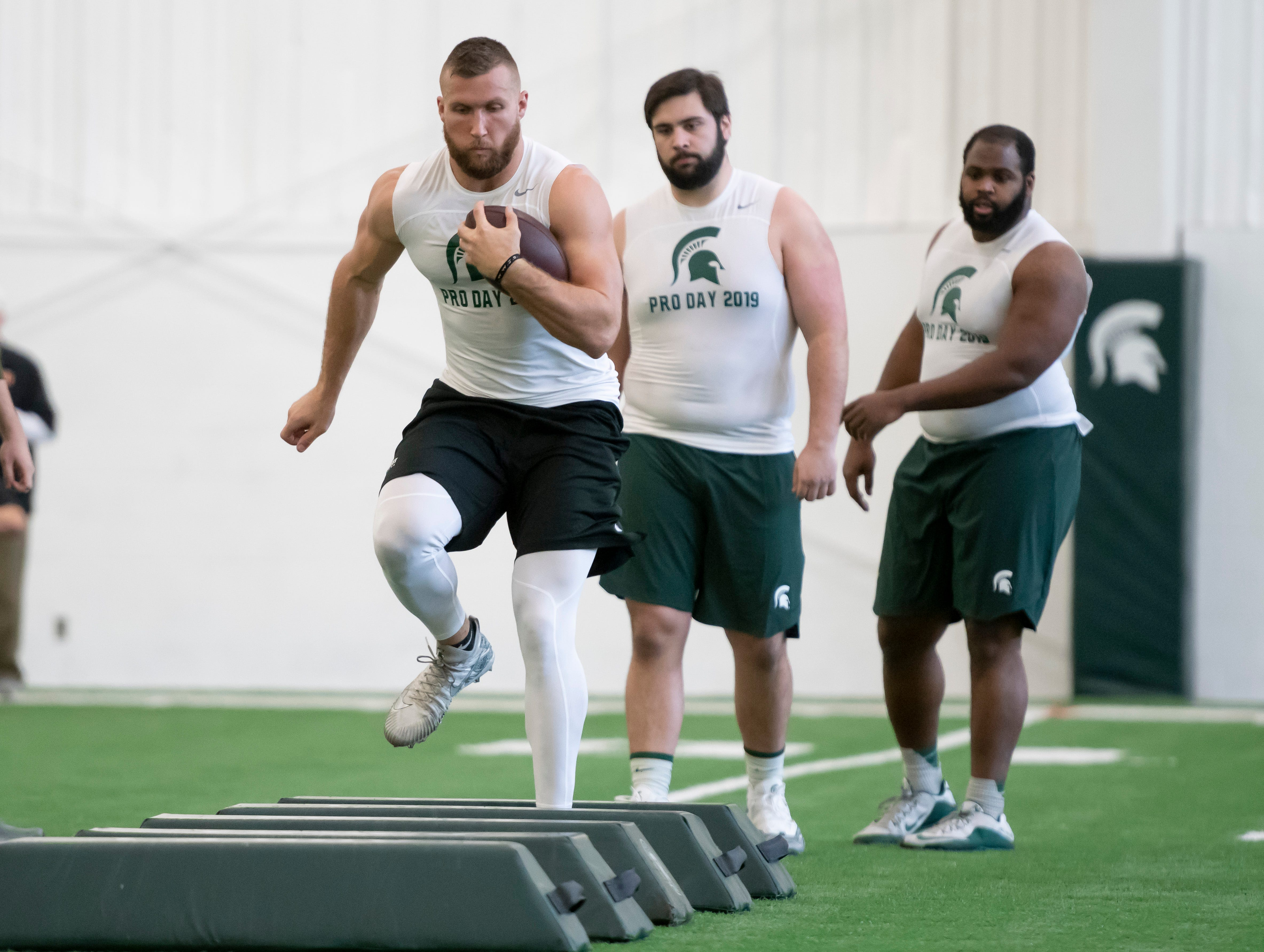 (From left) Michigan State tight end Matt Sokol, offensive lineman David Beedle, and defensive tackle Gerald Owens, go through drills.