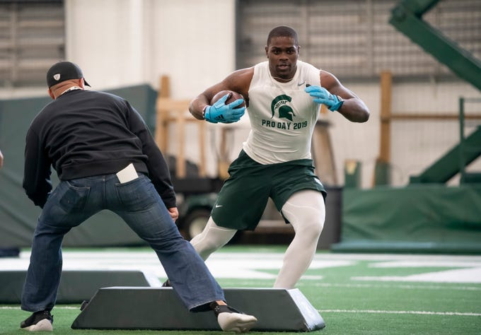 Michigan State running back LJ Scott runs through drills during an NFL pro day Monday, March 18, 2019, at the Duffy Daugherty Football facility, in East Lansing