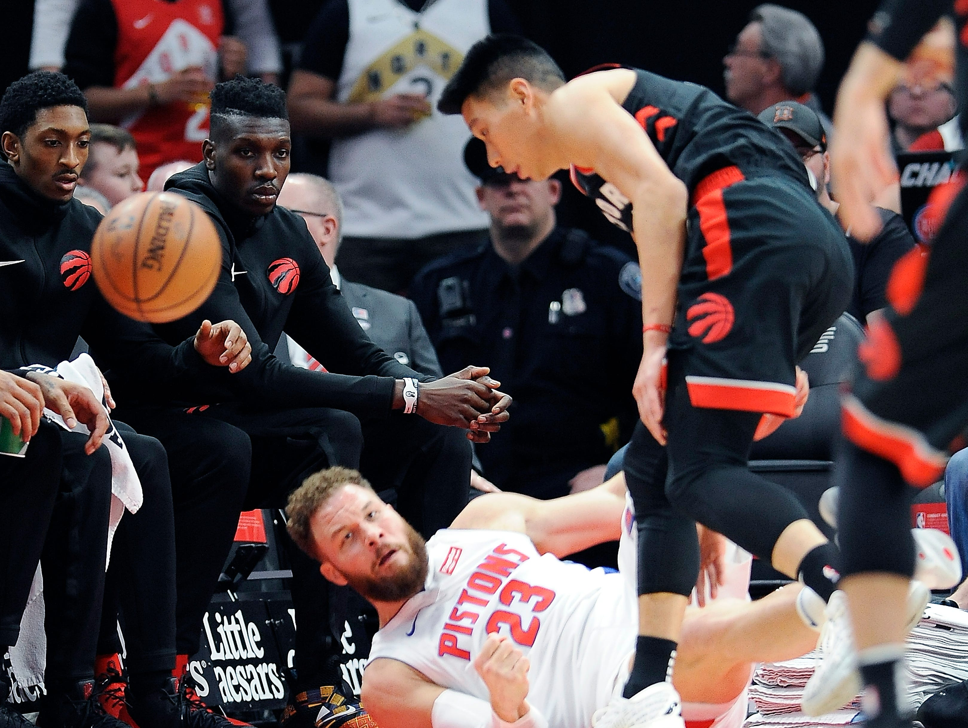 Pistons' Blake Griffin and Raptors' Jeremy Lin collide going for a loose ball in the first quarter.