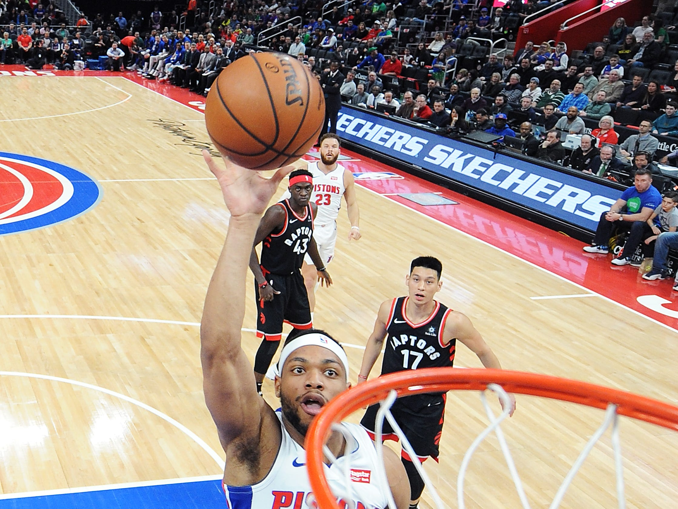 Pistons' Bruce Brown shoots over Raptors' Danny Green in the first quarter.