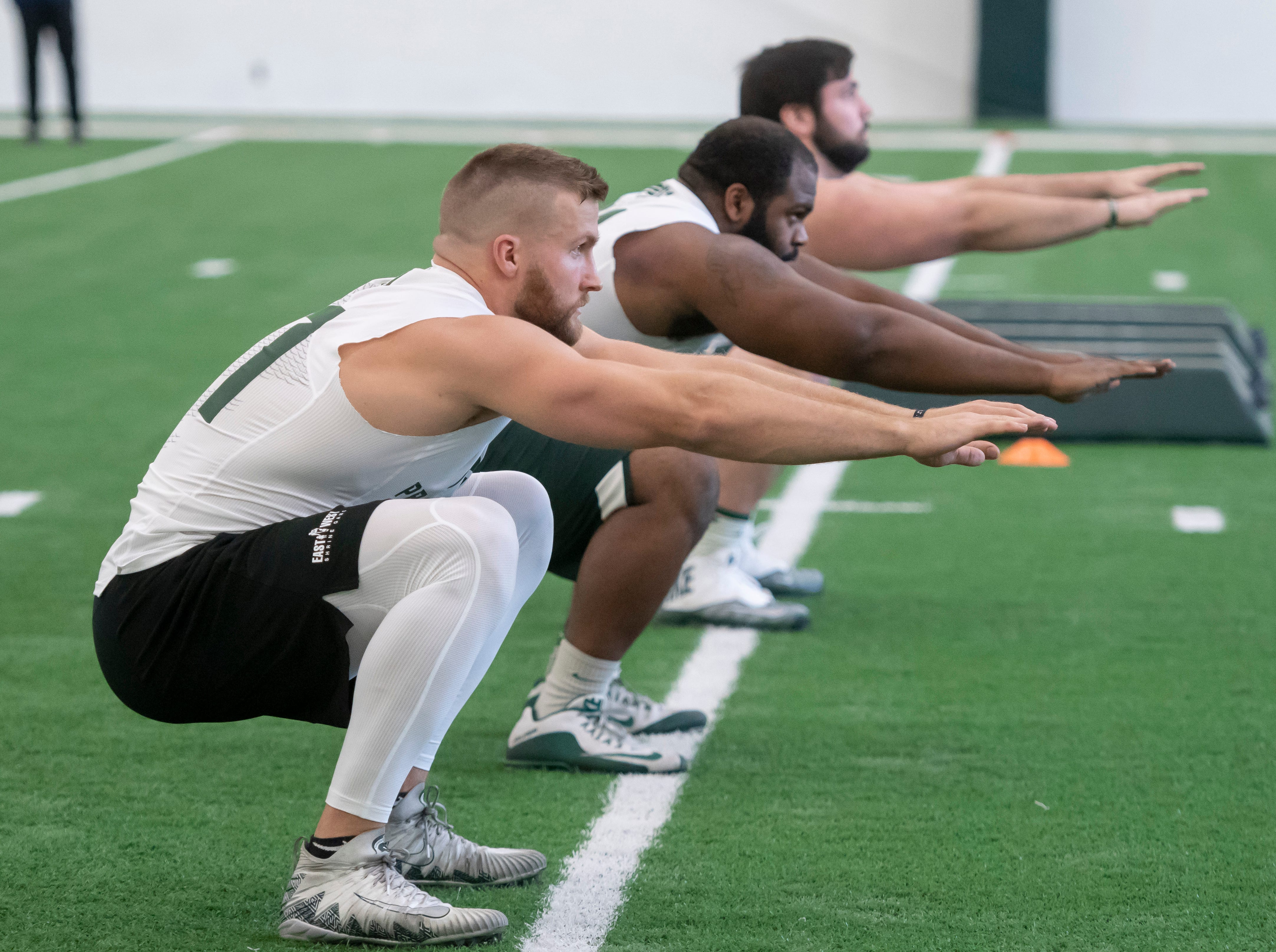 (From left) Michigan State tight end Matt Sokol, defensive tackle Gerald Owens, and offensive lineman David Beedle go through drills.