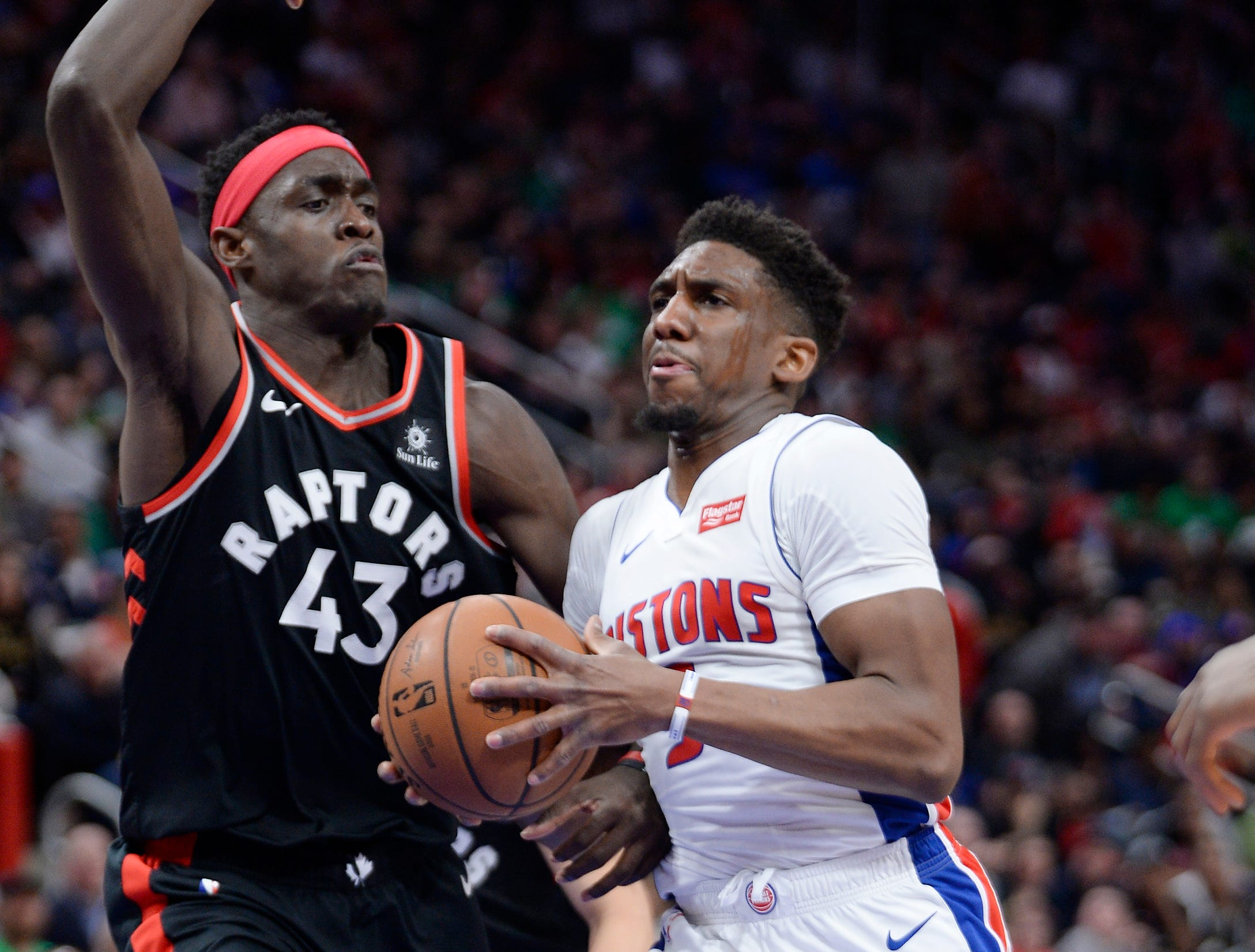 Pistons' Langston Galloway drives around Raptors' Pascal Siakam in the third quarter.