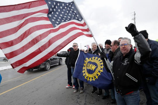 Mark Franko, a 28-year General Motors Co. employee, holds an American flag as employees gather outside the automaker's Lordstown Assembly Plant. GM ended production there on March 6.