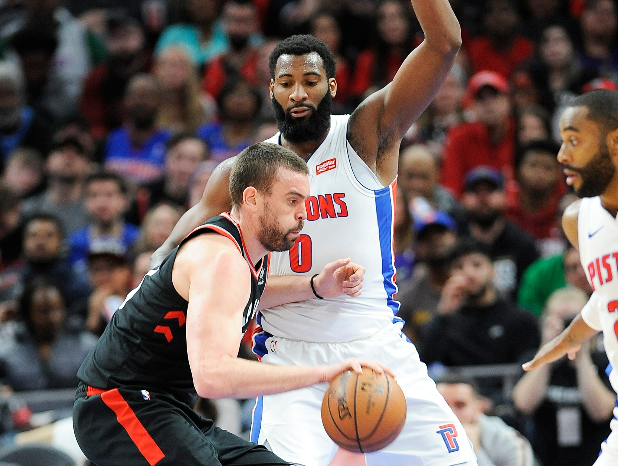 Raptors' Marc Gasol looks for room around Pistons' Andre Drummond in the third quarter.
