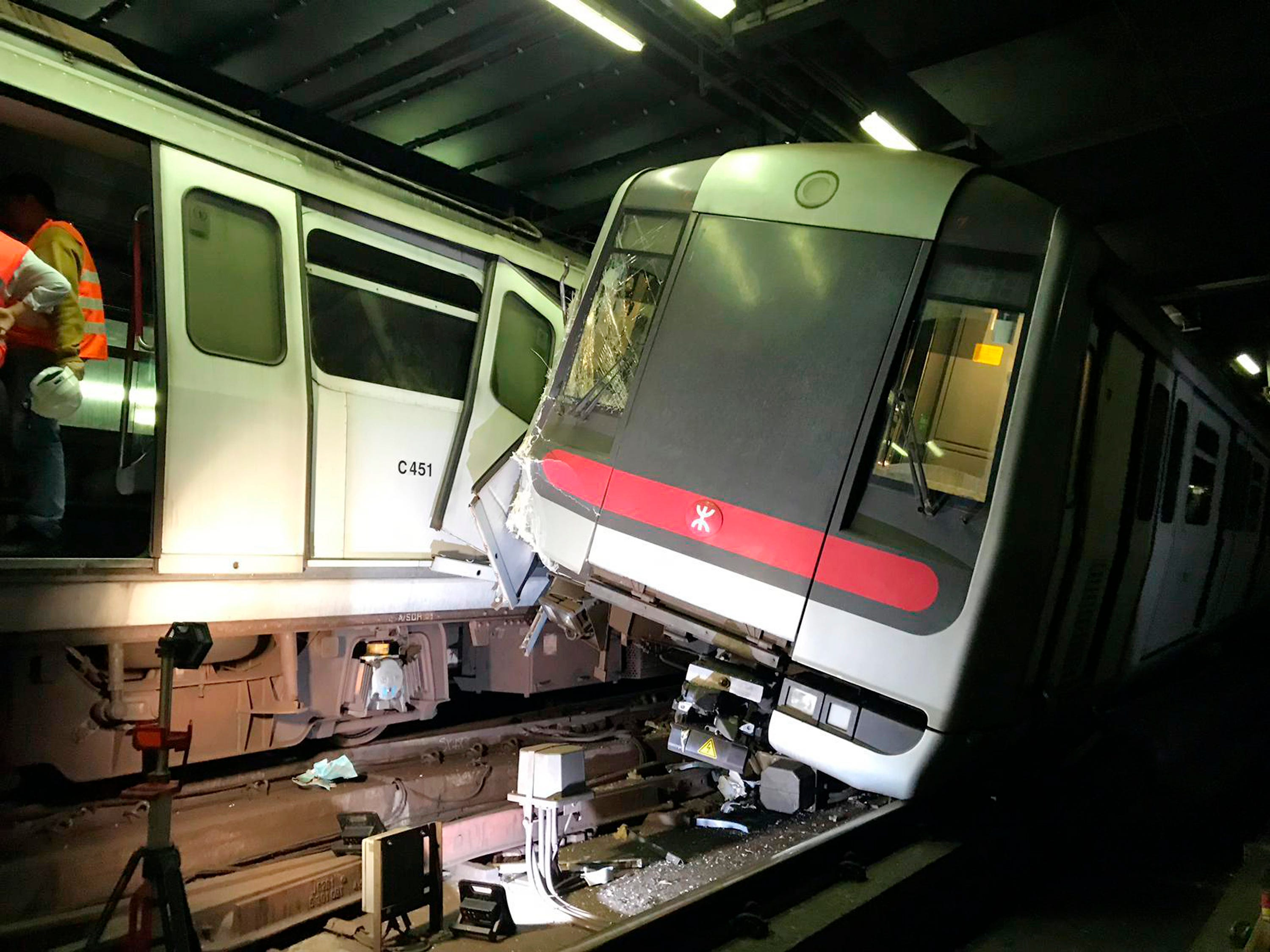 In this photo released by MTR Corporation, two MTR trains sit after collision on the Tsuen Wan Line during testing of the rail company's new signal system in Hong Kong Monday, March, 18, 2019. Two Hong Kong subway trains collided in early hours on Monday, leaving one train driver suffered leg injury and the other felt unwell after inhaling smoke. It cause service suspensions between affected stations.