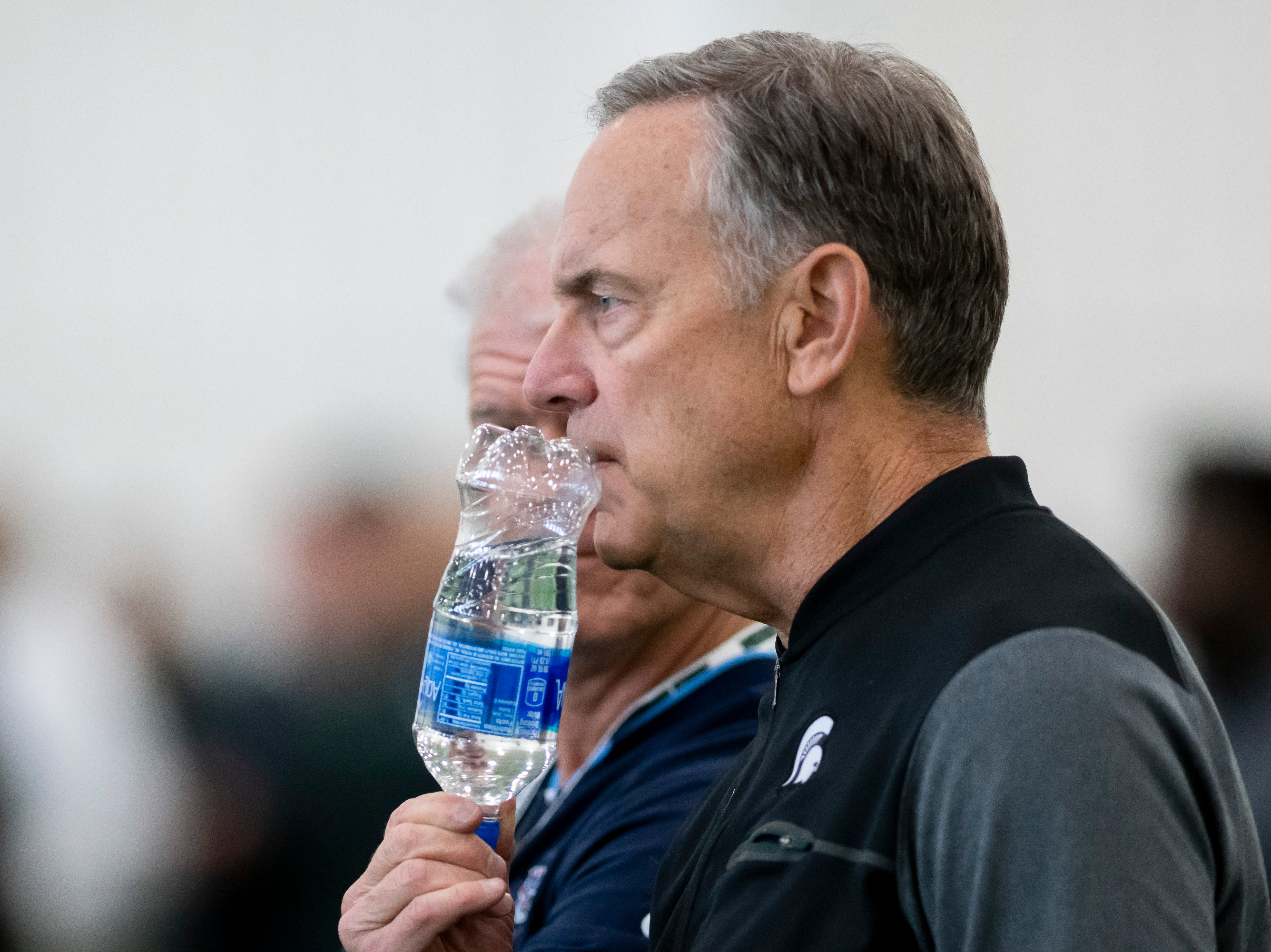 Michigan State head coach Mark Dantonio watches his players during an NFL pro day.