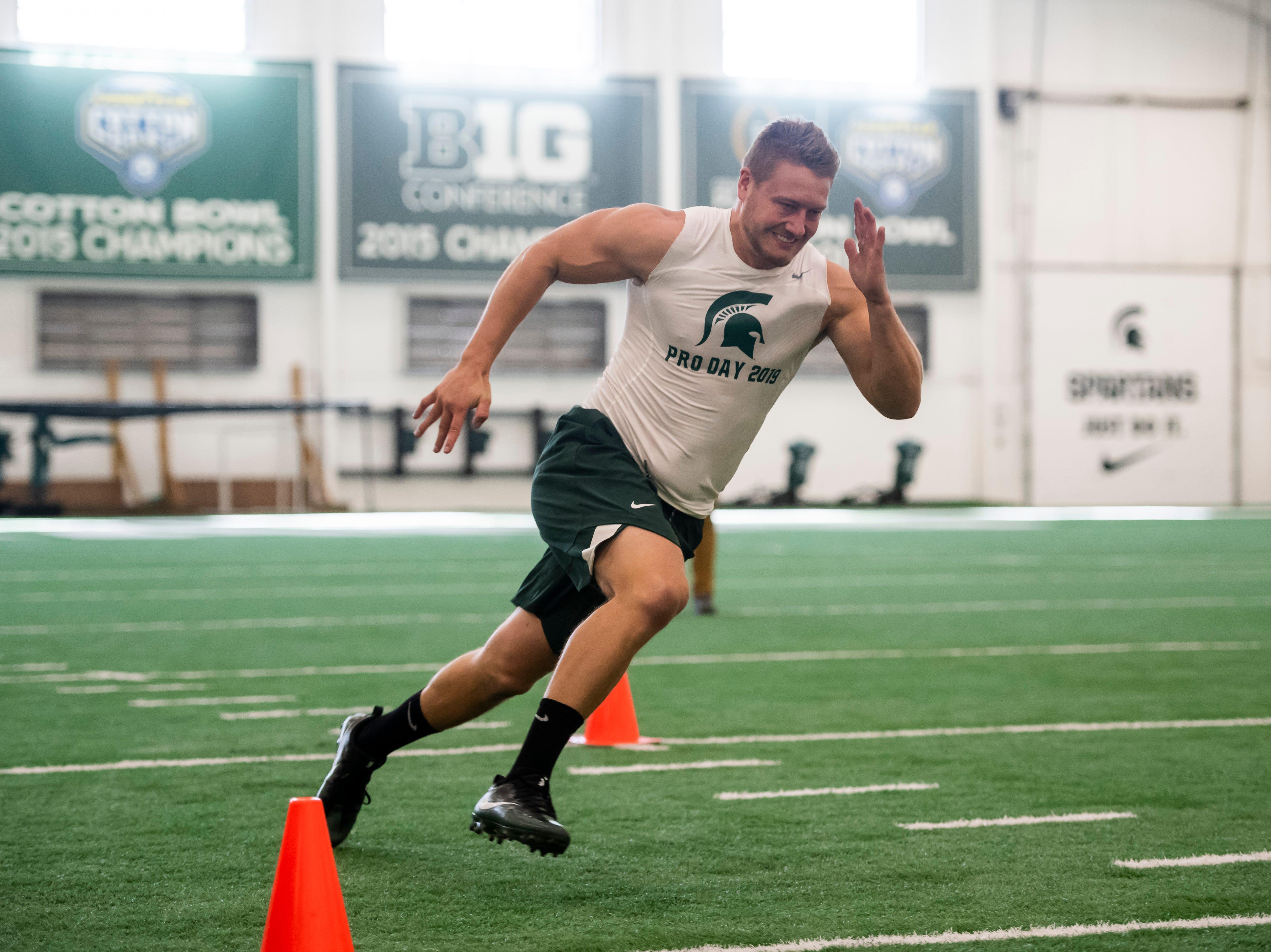 Michigan State linebacker Jon Reschke runs through shuttle drills.