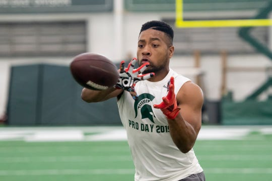 Michigan State safety Khari Willis catches a pass during an NFL pro day.