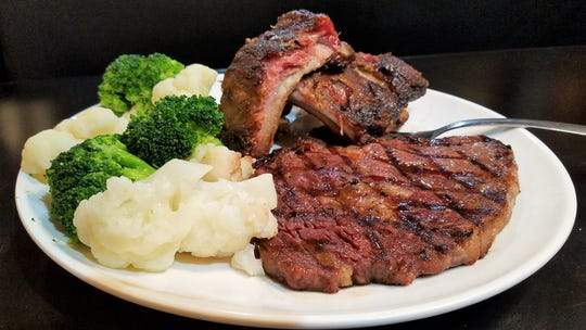 A certified Angus ribeye steak and ribs combo from the Red Onion in Equality, Illinois.