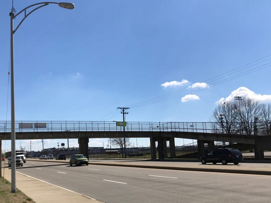 A pedestrian walkway to AIS-Diamond, the former Evansville North High School, stretches over Diamond Avenue. A recent petition calls for one to be built on the South Side for Bosse High School students.