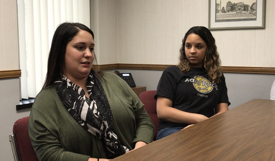 Hailie Prater, right, and Casey Wilson, an investigator and caseworker with Sandusky County Department of Job and Family Services, talk about the stressful experiences they have had in the field.