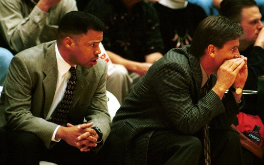 Ritchie McKay, then CSU's head coach, looks on as assistant Dale Layer yells instructions to the Rams during a Dec. 4, 1999, game against Oregon State at Moby Arena.