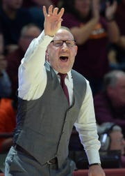 Virginia Tech men's basketball coach Buzz Williams gives instructions to his team during a Feb. 18 game against Virginia. Williams, a former CSU assistant coach, could meet up with another former CSU coach, Liberty's Ritchie McKay, in the second round of the NCAA tournament if both teams win their first-round games. Another former CSU coach, who worked with both McKay and Williams in Fort Collins, is in his first season as a special assistant to the head coach under Williams at Virginia Tech.