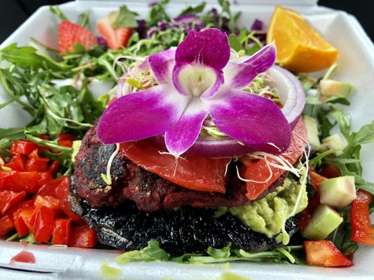A roasted portobello stuffed with guacamole and a black-bean burger from Sanibel Sprout.