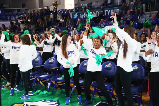 Members of the Florida Gulf Coast University women's basketball team react to a video recording at a watch party for the NCAA tournament at Alico Arena on Monday. Players from right are Alyssa Blair, Keri Jewett-Giles, Chandler Ryan, Lisa Zderadicka, and Sheahen Dowling. They are a No. 13 seed and will play Miami on Friday at 9 p.m.