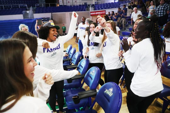 Members of the FGCU women's basketball team react to a video recording of a NCAA watch party at Alico Arena on Monday. Included is Kerstie Phills, left, and Nasrin Ulel, right. They are playing Miami on Friday at 9 p.m.
