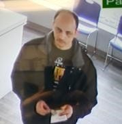 Green Bay Police want public's help identifying man connected to strong-arm robbery