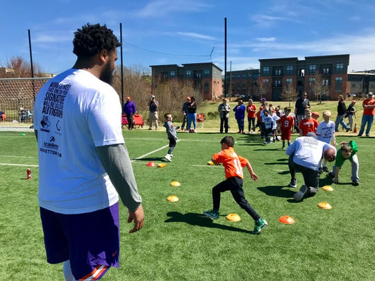 Christian Wilkins watches as campers navigate his cone drill Sunday afternoon at Greenville's Kroc Center.