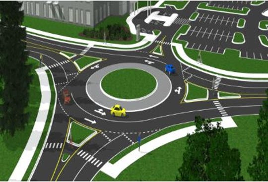 A concept drawing of how a traffic circle will handle vehicles as part of a Woodruff Road bypass connector to Verdae Boulevard.