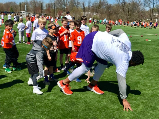 Former Clemson football standout Christian Wilkins displays a proper stance for youth campers Sunday afternoon in Greenville.