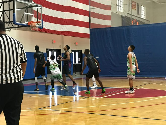 The University of Guam Men's Basketball Team faced off against the Guam Navy base Slime team during the March Madness basketball tournament on March 17, 2019 at Andersen Air Force Base.