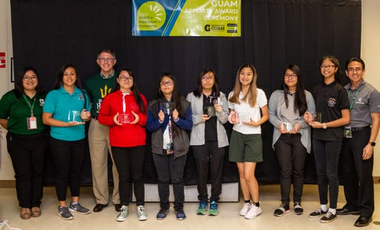 Seven young women from Guam's public high schools were honored for their computing-related achievements and interests during University of Guam's TechFest, which was part of UOG's Charter Day festivities on March 12. Julienne Juaneza of Southern High School won the National Center for Women in Information Technology (NCWIT) Aspirations in Computing Award, while six other students were recognized with honorable mentions. From left: Jaevåni Isidro, Computer Center assistant at UOG; Julienne Juaneza; Thomas W. Krise, president of UOG; Dior Nguyen; Judy Marie Delos Reyes; Bianca De Los Angeles; Angeline Francisco; Maria Luceline Alfonso; Yssabelle Valencia; and Rommel Hidalgo, chief information officer for UOG.