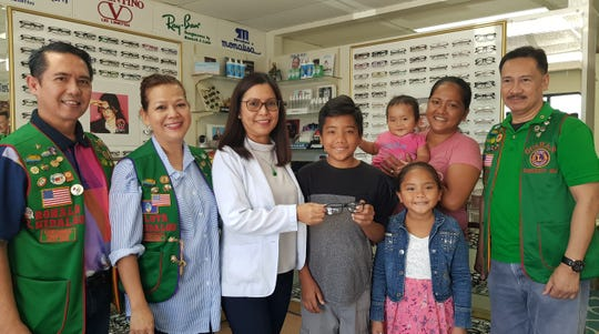 Guam Guahan Lions Club in conjunction with Garcia Optical in Tamuning donated prescription eye glasses to Patrick Arriola, a deserving student of Okkodo High School on Feb. 2. From left: Lion Ron Hidalgo (IPP), Lion Lota Hidalgo (secretary), Dr. Henny Garcia, Patrick Arriola and his family and Lion Lito Pesebre (president).