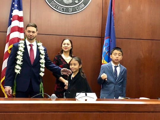 Del. Mike San Nicolas and his family during San Nicolas' ceremonial swearing-in Monday morning in the U.S. District Court of Guam.