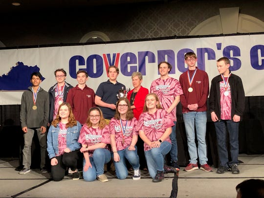 Henderson County High School academic team members collect their third place overall trophy at the Governor's Cup state tournament at the Galt House hotel in Louisville Monday, March 18. Team members are, front row, from left: Maggie Privette, Abby Salisbury, Julianne Latimer, and Riley Lovell. Back row, Alex Edwin, Wil Kyle, Harrison Jenkins, DJ Banks, Alex Chandler, Logain North and Josh Freeman.