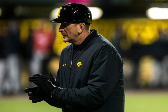 Even when games can be played at Banks Field in the first 50% of the regular season, the weather is often cold or rainy, as evidenced in this photo of Iowa coach Rick Heller in a March 17, 2019, game.